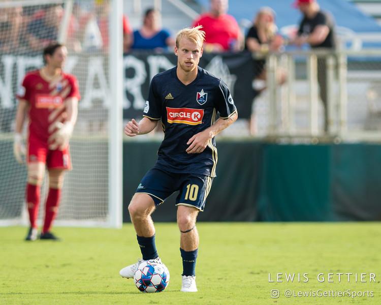 North Carolina FC midfielder Kyle Bekker (10)