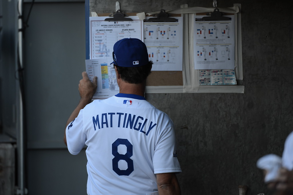 . Los Angeled Dodger\'s manager Don Mattingly reviews the lineup before game 3 of the NLDS at Dodger Stadium Sunday, October 6, 2013. (Photo by David Crane/Los Angeles Daily News)