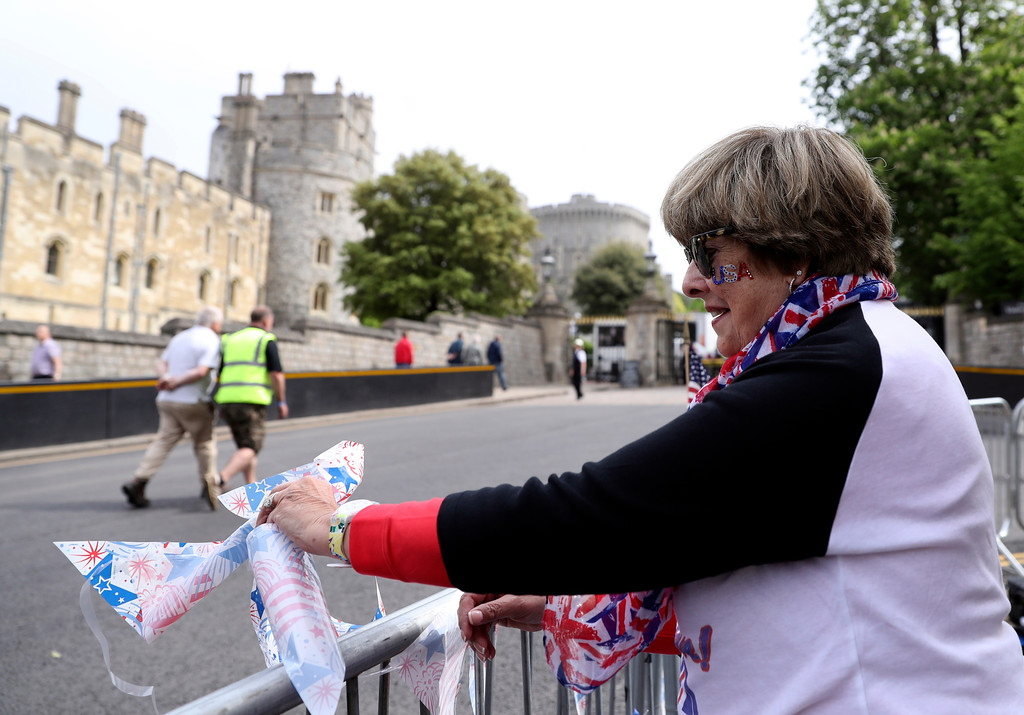 . American royal fan Donna Werner, and who has come over to Britain specially for the upcoming royal wedding of Britain\'s Prince Harry and Meghan Markle, shows off her placards in her position along the carriage route in Windsor, England, Wednesday, May 16, 2018. Preparations continue in Windsor ahead of the royal wedding of Britain\'s Prince Harry and Meghan Markle Saturday May 19, which includes a 30 minute carriage route taking the couple round the town to wave to the crowds, some of whom are already taking up positions . (AP Photo/Alastair Grant)