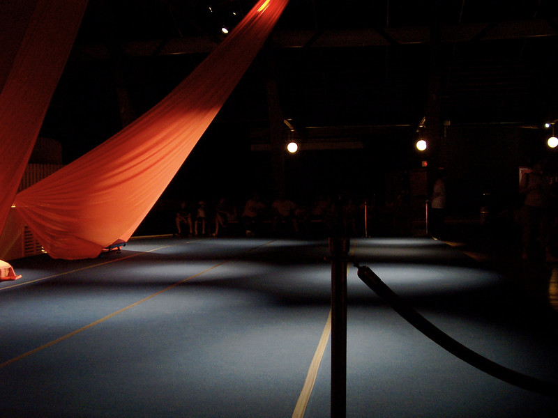 There are aerial silks tied to the rafters and a foam mat on the floor.