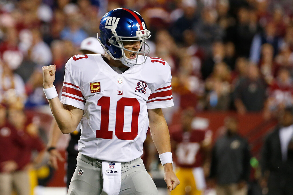 . New York Giants quarterback Eli Manning reacts to his touchdown pass to Larry Donnell during the first half of an NFL football game against the Washington Redskins in Landover, Md., Thursday, Sept. 25, 2014. (AP Photo/Alex Brandon)