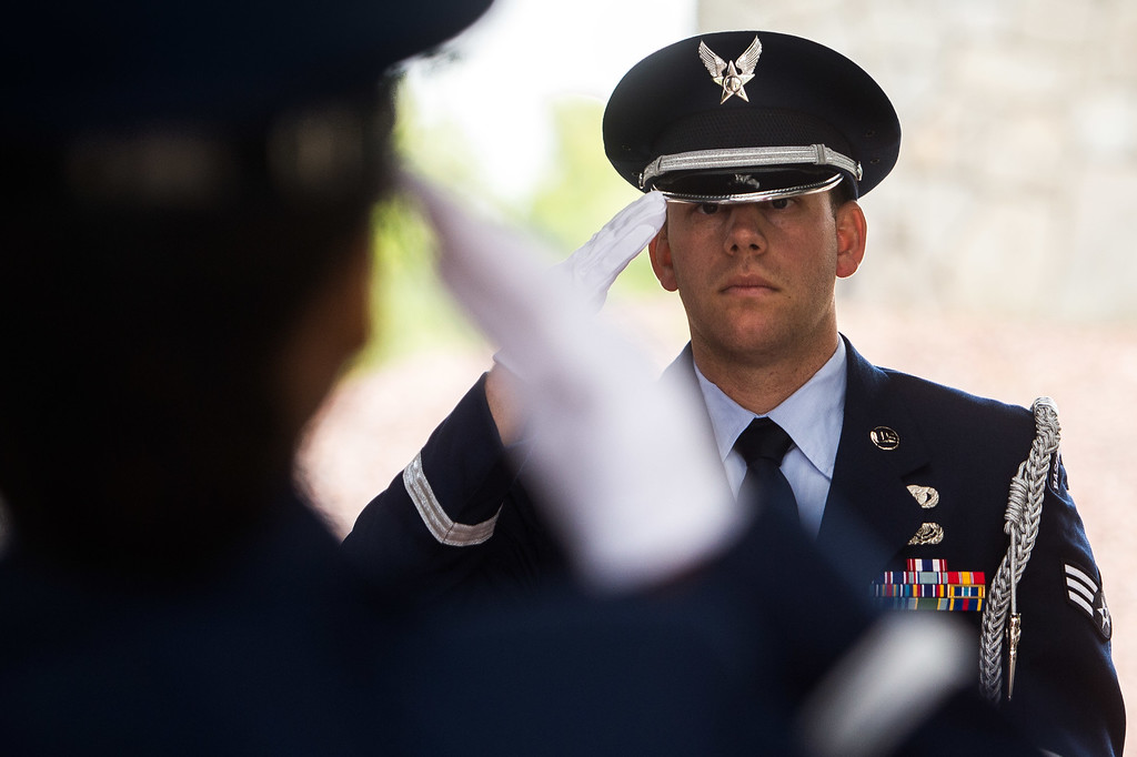 . The Blue Eagles Honor Guard members Senior Airman Joseph Trujillo, right, and Staff Sgt. Zakia Webster stand at attention over the casket of Airman First Class Roland Morgan at Riverside National Cemetery in Riverside, Calif. on Tuesday, May 19, 2015. (Photo by Watchara Phomicinda/ Los Angeles Daily News)