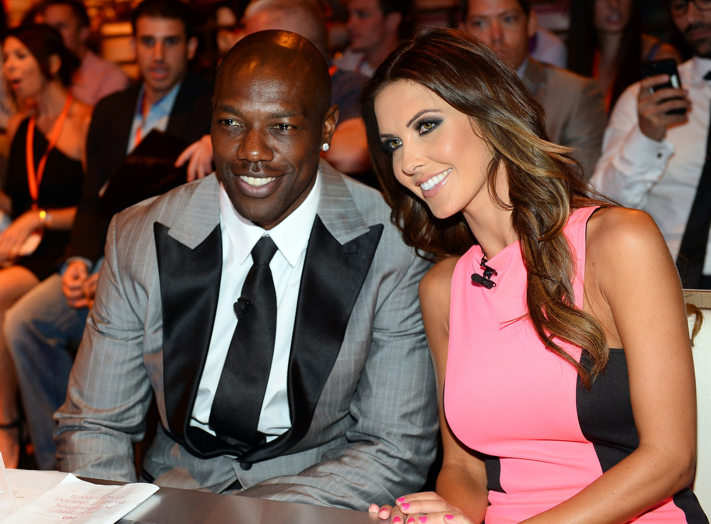 . NFL free agent Terrell Owens (L) and television personality Audrina Patridge appear before judging the 17th annual Hooters International Swimsuit Pageant at The Joint inside the Hard Rock Hotel & Casino on June 27, 2013 in Las Vegas, Nevada.  (Photo by Ethan Miller/Getty Images)