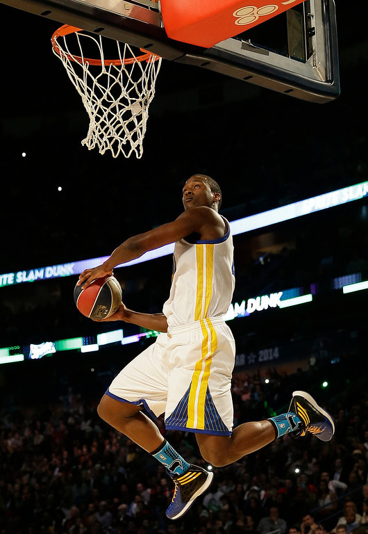 . Paul George of the Indiana Pacers participates in the slam dunk contest during the skills competition at the NBA All Star basketball game, Saturday, Feb. 15, 2014, in New Orleans. (AP Photo/Gerald Herbert)