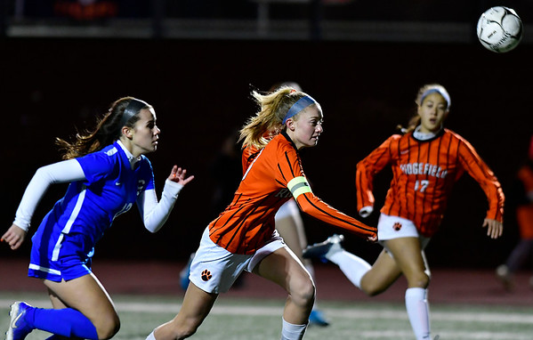 11/19/2019 Mike Orazzi | Staff Southington High School's Maya Wroblewski (13) and Ridgefield High School's Carolyn Donovan (3) during the Class LL Semifinal Girls Soccer match at Naugatuck High School Tuesday night. Southington advanced to the final 1-0.