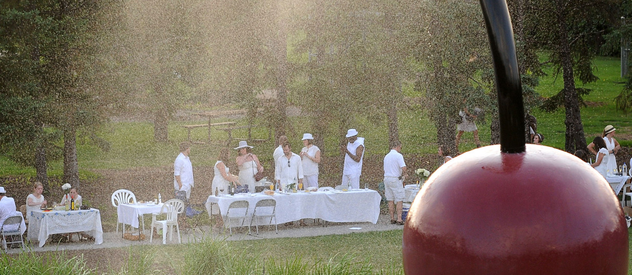 ". The mist from the ""Spoonbridge and Cherry\"" sculpture gives the gathering a painterly quality. (Pioneer Press: Sherri LaRose-Chiglo)"