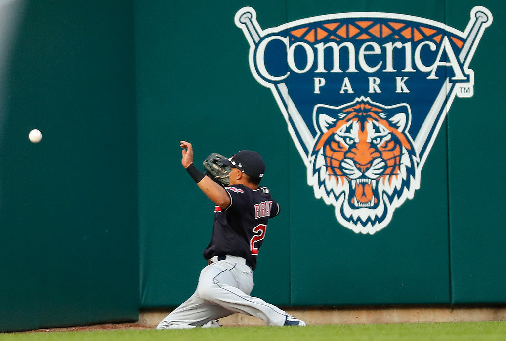 . Cleveland Indians left fielder Michael Brantley cannot reach a Detroit Tigers\' Niko Goodrum ground-rule double in the third inning of a baseball game in Detroit, Friday, July 27, 2018. (AP Photo/Paul Sancya)