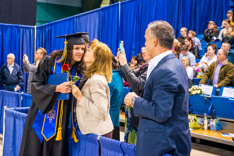 Ann-Cathrin Uhl, who earned a bachelor's degree in business administration, greets her parents after UAF's commencement ceremony in the Carlson Center on May 5, 2018.