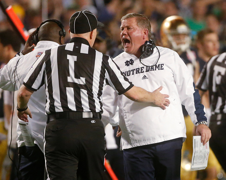 . Notre Dame head coach Brian Kelly argues a call during the first half of the BCS National Championship college football game against Alabama Monday, Jan. 7, 2013, in Miami. (AP Photo/John Bazemore)