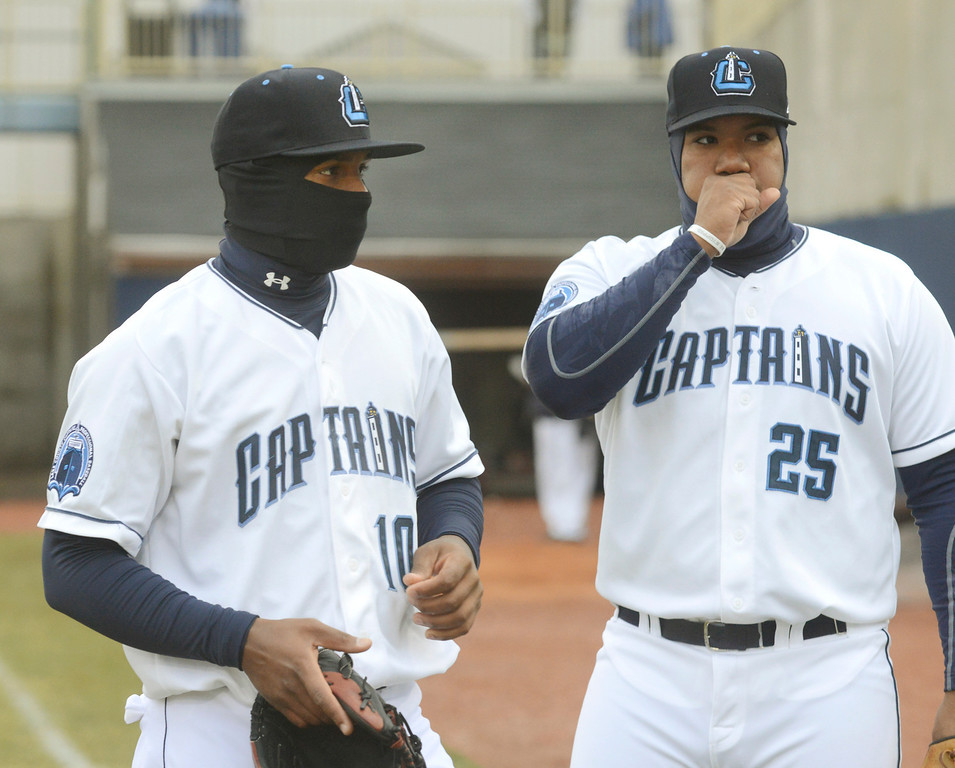. Maribeth Joeright/MJoeright@News-Herald.com<p> Captains second baseman Claudio Bautista, left, and first baseman Nellie Rodriguez do what they can to stay warm as they loosen up before the start of their opening game against the Lansing Lugnuts.