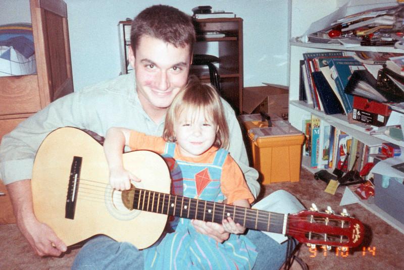 Matt & Tahirih with guitar.jpg