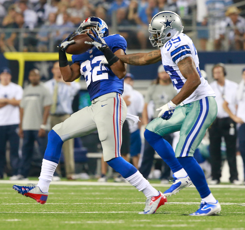 . New York Giants wide receiver Rueben Randle (82) catches a pass for a first down, tackled by Dallas Cowboys cornerback Brandon Carr (39) during the second half of an NFL football game, Sunday, Sept. 8, 2013, in Arlington, Texas. (AP Photo/Waco Tribune Herald, Jose Yau)