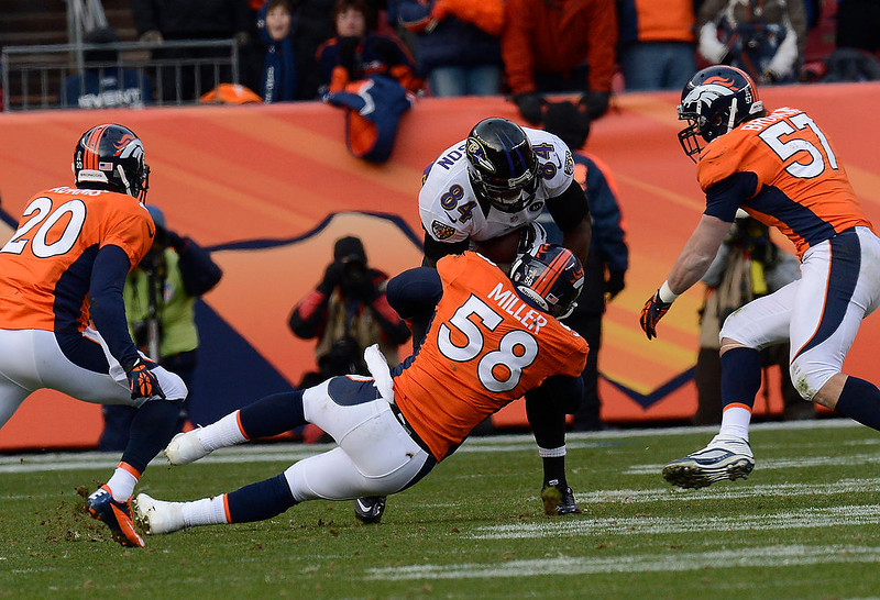 . Denver Broncos outside linebacker Von Miller (58) takes down Baltimore Ravens tight end Ed Dickson (84) in the second quarter. The Denver Broncos vs Baltimore Ravens AFC Divisional playoff game at Sports Authority Field Saturday January 12, 2013. (Photo by Joe Amon,/The Denver Post)