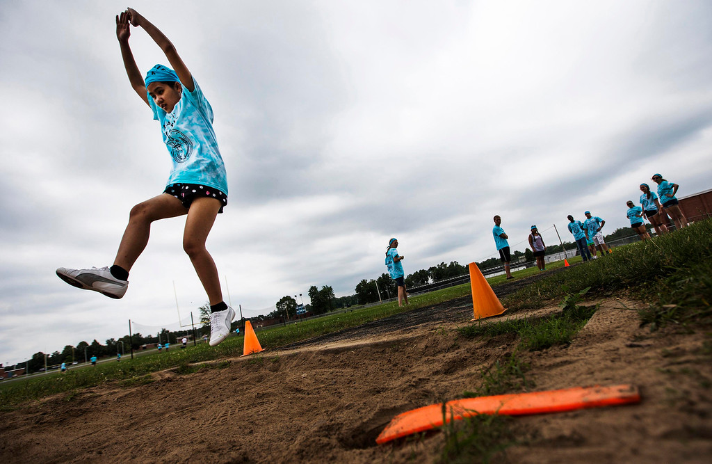 . Dah Ku participates in long jump at Camp Abilities in Brockport, New York, June 25, 2013. Camp Abilities is a not-for-profit week-long developmental camp using sports to foster greater independence and confidence in children who are blind, visually impaired, and deaf-blind. Photo taken June 25, 2013.   REUTERS/Mark Blinch