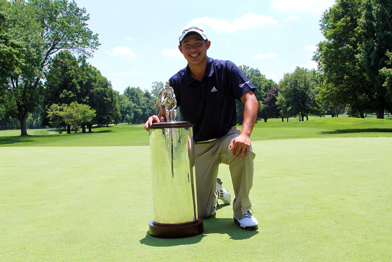 Collin Morikawa poses with the Woodard trophy at the conclusion of the 96th Western Junior Championship.