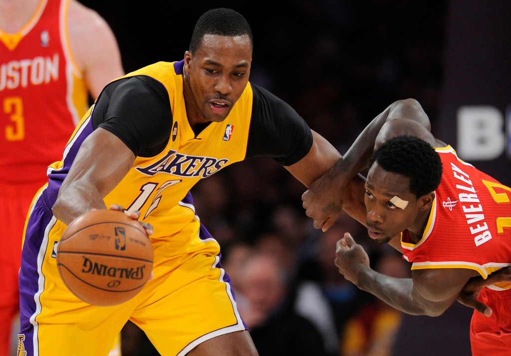 . Lakers #12 Dwight Howard and Rockets #12 Patrick Beverly battle for a loose ball in the first quarter. The Lakers faced the Houston Rockets in the final home game of the year at Staples Center in Los Angeles, CA 4/17/2013 (John McCoy/Staff Photographer
