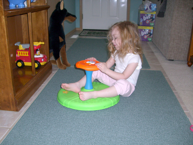 Playing with the sit-n-spin from Uncle Chad.