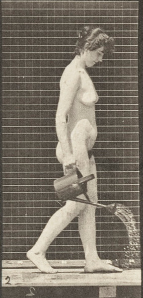 Nude woman walking, turning around and using a sprinkling pot