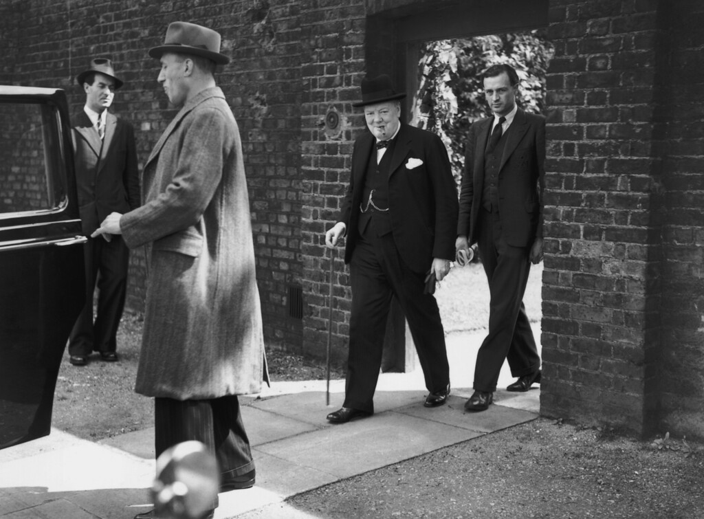 . On VE Day, 7th May 1945, in London, British Prime Minister Winston Churchill (1874 - 1965) leaves 10 Downing Street by the back entrance to avoid the large crowds awaiting his appearance. (Photo by Keystone/Hulton Archive/Getty Images)