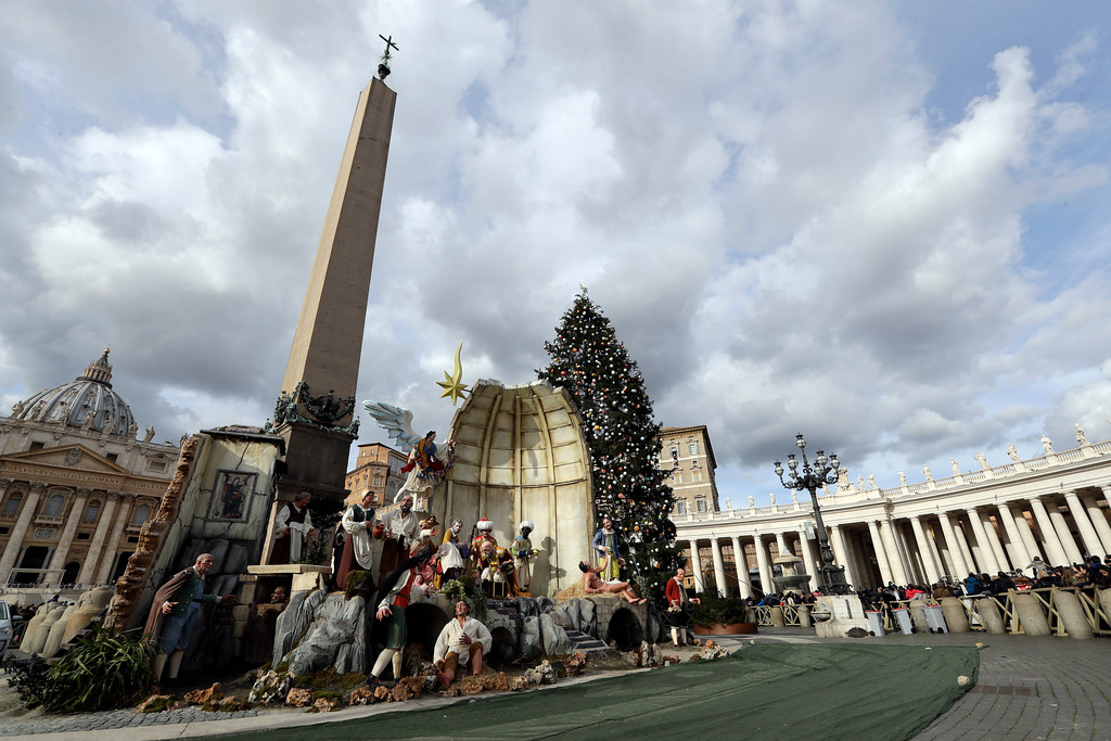 . The nativity scene is seen in the foreground as Pope Francis, small figure at the window second from right of the top floor of the Apostolic Palace in the background, recites the Angelus prayer overlooking St. Peter\'s Square, at the Vatican, Friday, Dec. 8, 2017. (AP Photo/Andrew Medichini)