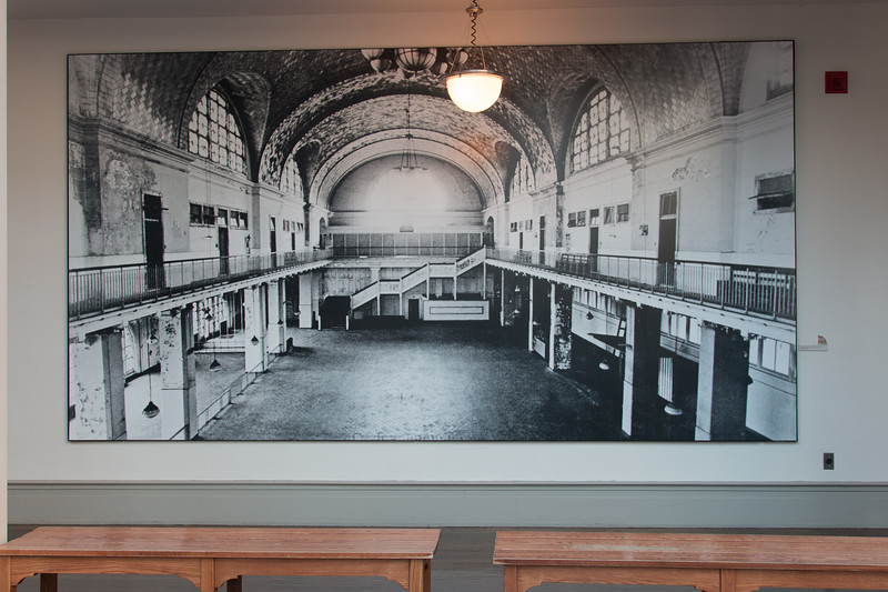 """Photo on the wall labeled, """"1971. The room during the period of abondonment after the closeing of Ellis Island in 1954. © 1971 Wilton S Tifft""""  [This is very similar to my photo fro August 1984"""") -- A trip to Ellis Island, June 22, 2017."""