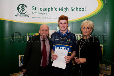 Principal John Jones and VP Marie Mulligan are pictured with pupil Liam McArdle. R1435002