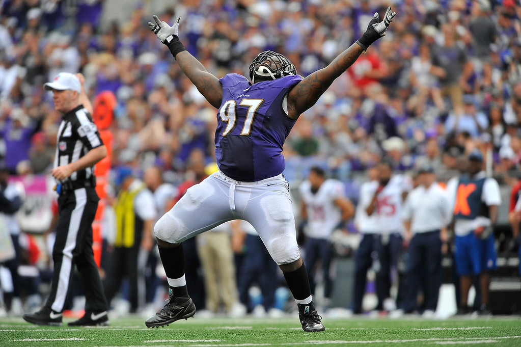 . Defensive end Arthur Jones #97 of the Baltimore Ravens celebrates a sack against the Houston Texans at M&T Bank Stadium on September 22, 2013 in Baltimore, Maryland. The Ravens defeated the Texans 30-9. (Photo by Larry French/Getty Images)