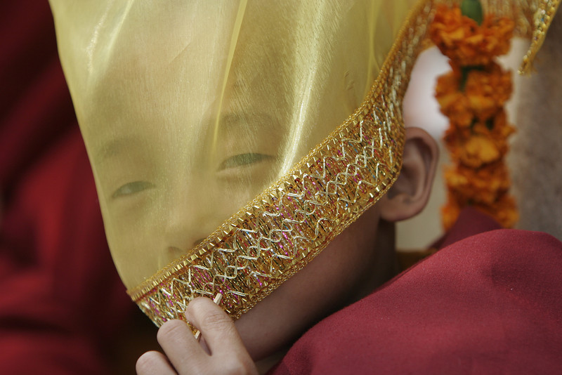 Mahabodhi Temple (7 of 15)  A novice monk peeking through sheer fabric
