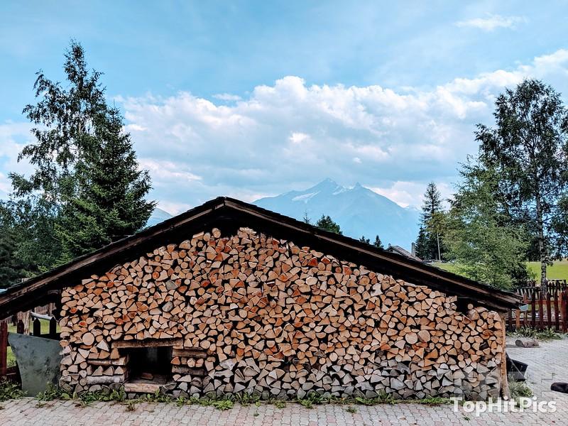 A Cabin With A Wooden Wall In Vetan, Aosta, Italy