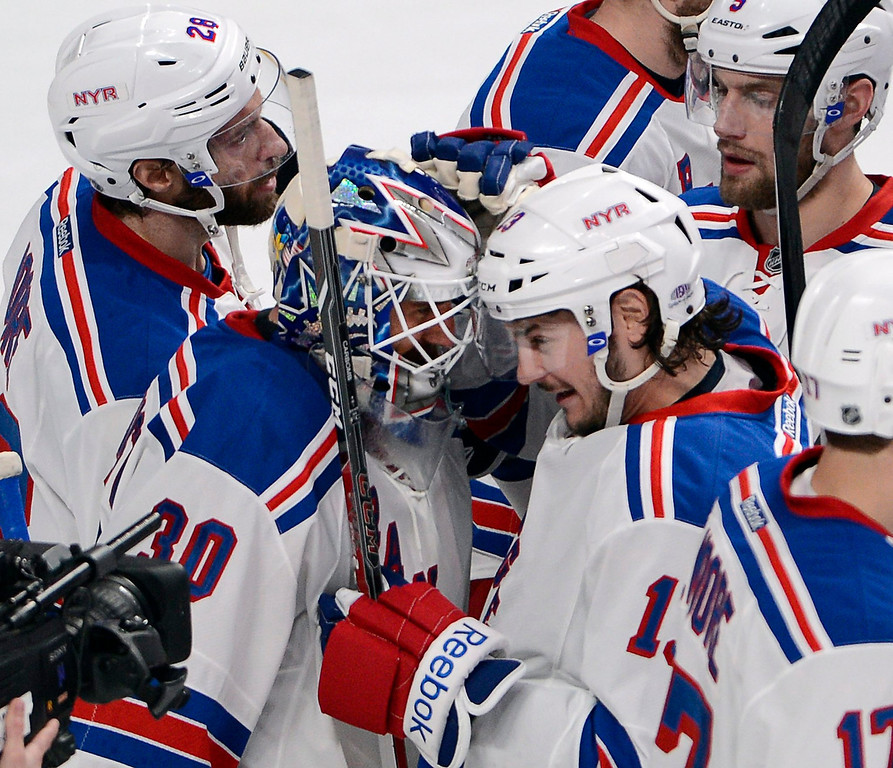 . New York Rangers goalie Henrik Lundqvist (30) is congratulated by New York Rangers left wing Daniel Carcillo (13) after defeating the Montreal Canadiens 3-1 in Game 2 of the NHL Eastern Conference final Stanley Cup playoff action Monday, May 19, 2014, in Montreal. (AP Photo/The Canadian Press, Ryan Remiorz)