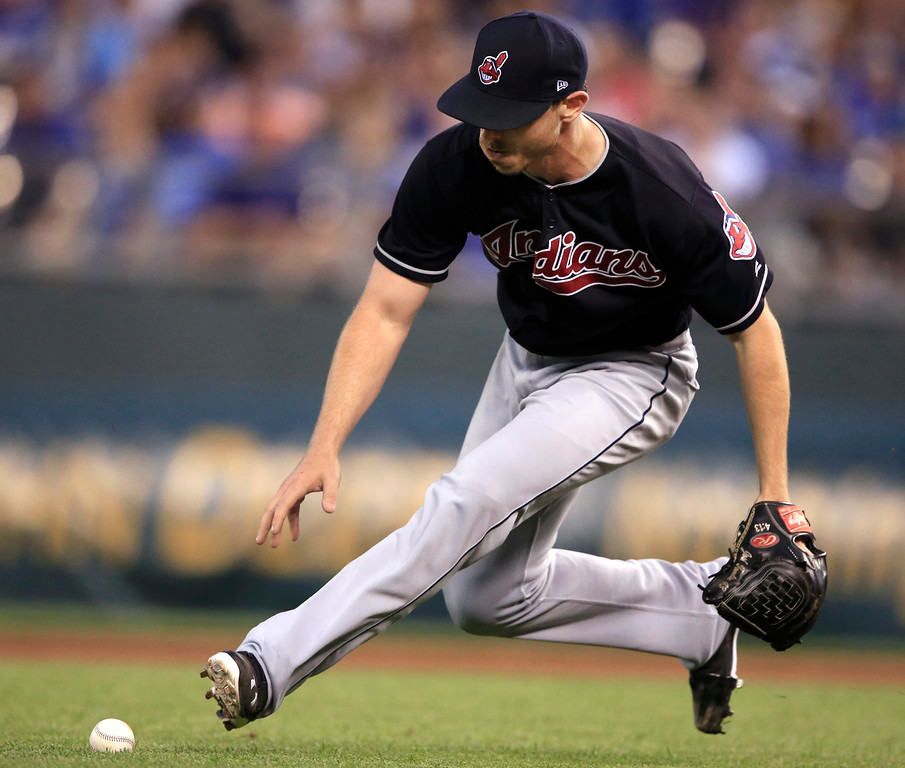 . Cleveland Indians starting pitcher Josh Tomlin chases down an infield grounder hit by Kansas City Royals\' Lorenzo Cain during the sixth inning of a baseball game at Kauffman Stadium in Kansas City, Mo., Friday, June 2, 2017. Cain was ruled safe at first base after review of the play. (AP Photo/Orlin Wagner)