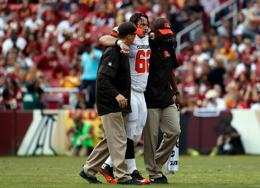 . Cleveland Browns center Austin Reiter (62) is helped off the field after an injury during the second half of an NFL football game against the Washington Redskins, Sunday, Oct. 2, 2016, in Landover, Md. The Redskins won 31-20. (AP Photo/Carolyn Kaster)