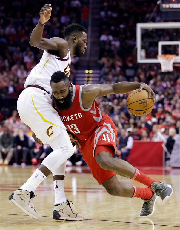 . Cleveland Cavaliers forward Jeff Green (32) defends as Houston Rockets guard James Harden (13) drives into him during the second half of an NBA basketball game Thursday, Nov. 9, 2017, in Houston. (AP Photo/Michael Wyke)