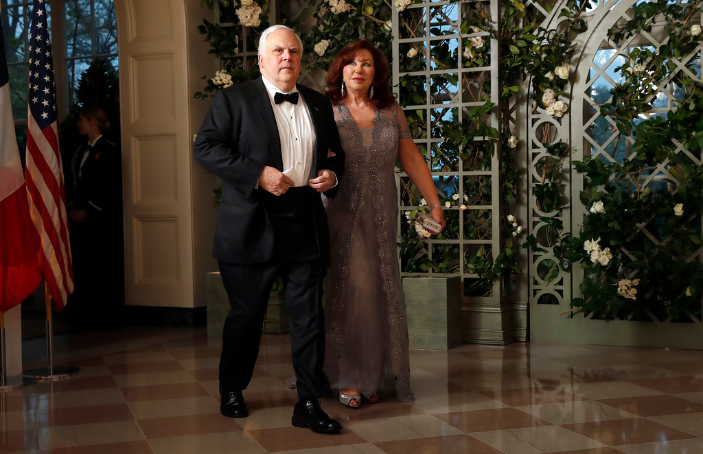 . Frederick Smith and Diane Smith arrive for a State Dinner with French President Emmanuel Macron and President Donald Trump at the White House, Tuesday, April 24, 2018, in Washington. (AP Photo/Alex Brandon)