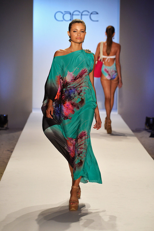 . A model walks the runway at the Caffe Swimwear show during Mercedes-Benz Fashion Week Swim 2014 at Oasis at the Raleigh on July 21, 2013 in Miami, Florida.  (Photo by Frazer Harrison/Getty Images for Caffe Swimwear)