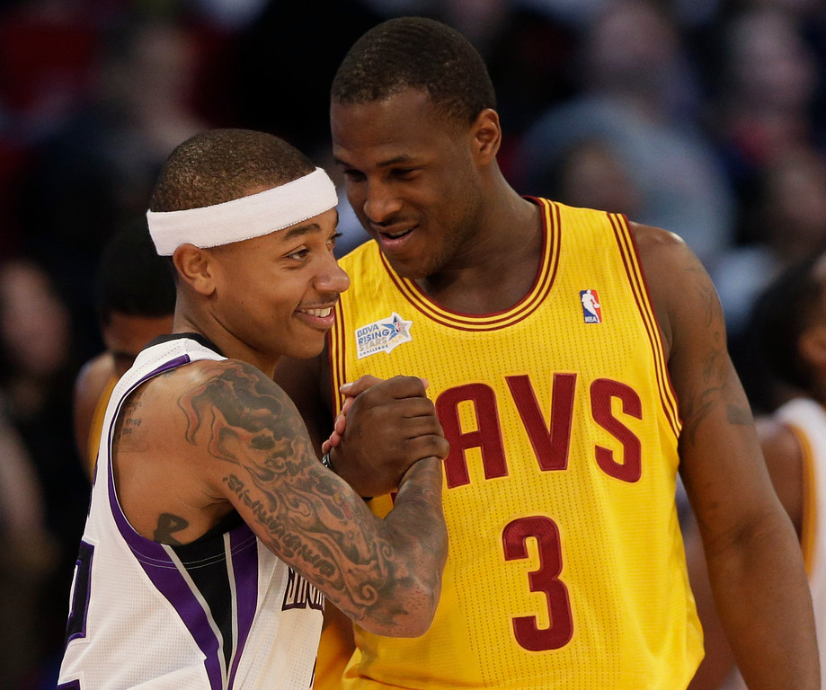 . Team Chuck\'s Isaiah Thomas, left, of the Sacramento Kings, and Team Shaq\'s Dion Waiters, of the Cleveland Cavaliers, shake hands during the second half of the Rising Stars Challenge basketball game at NBA All-Star Weekend, Friday, Feb. 15, 2013, in Houston. (AP Photo/Eric Gay)