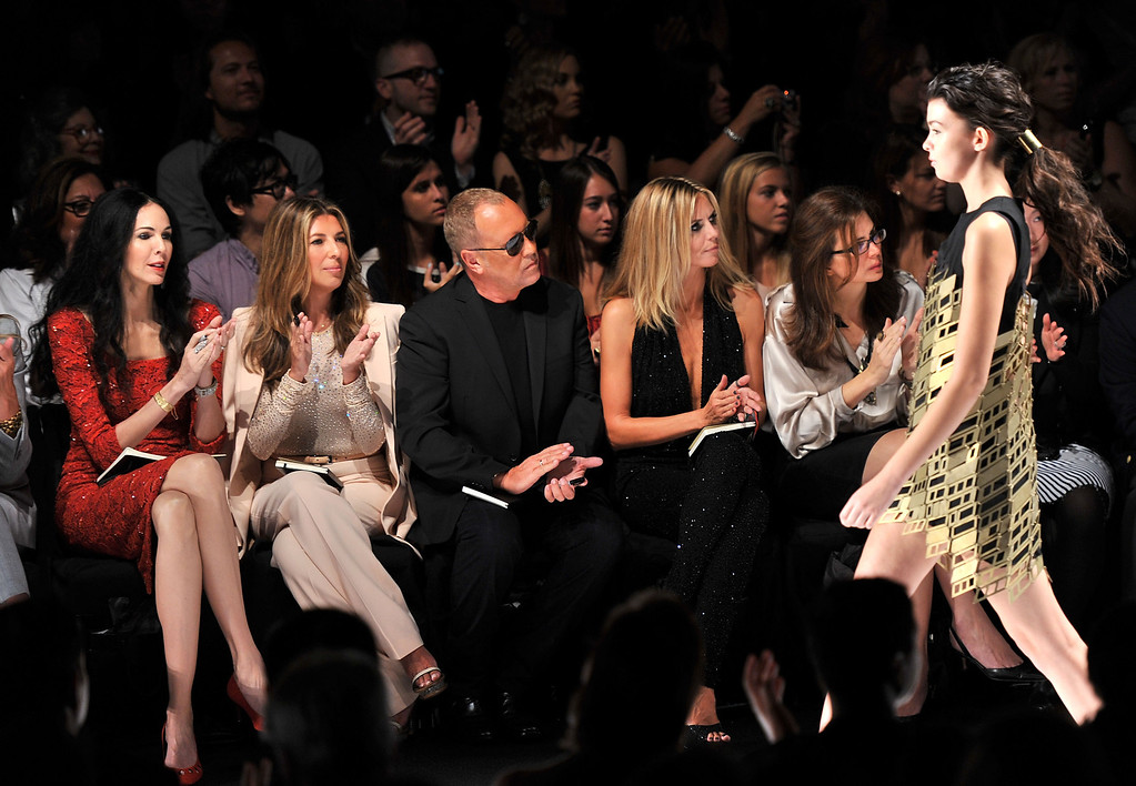 . (L-R) Project Runway judges L\'Wren Scott, Nina Garcia, Michael Kors, Heidi Klum and Desiree Gruber attend the Project Runway Spring 2012 fashion show during Mercedes-Benz Fashion Week at The Theater at Lincoln Center on September 9, 2011 in New York City.  (Photo by Stephen Lovekin/Getty Images for Mercedes-Benz Fashion Week)