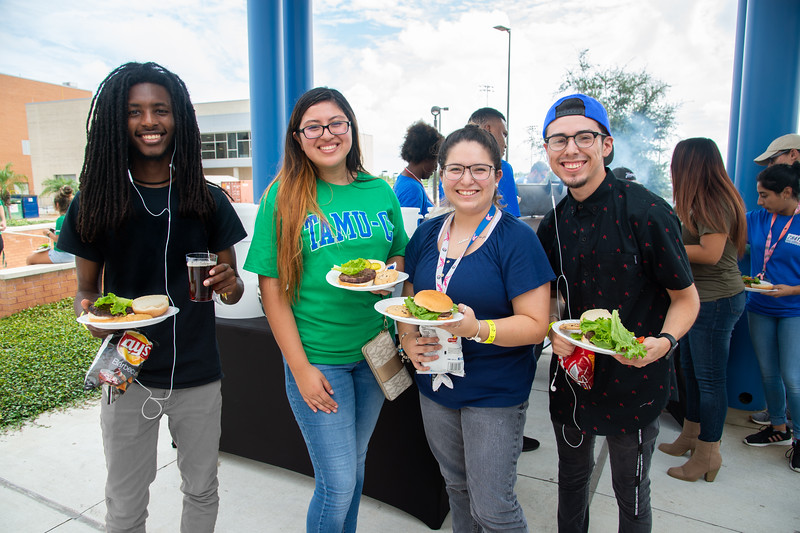 Christopher Tucker (left), Ashley Ventura, Valerie Luniz, and Juan Reyes stop by the All American Red, White and Blue cookout for some burgers at the UC Sea Breeze Patio