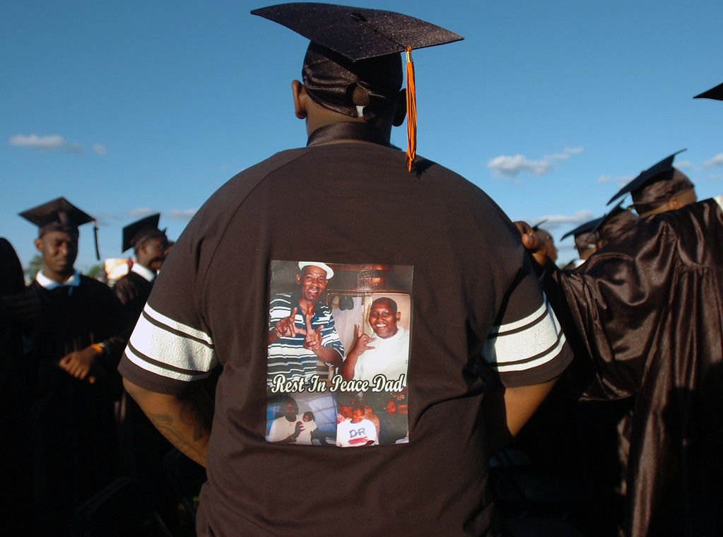 . Deshawn Watson displays a shirt he wore under his gown in memory of his father who passed away last year at Chester High School\'s graduation, Friday. (Times Staff / JULIA WILKINSON)