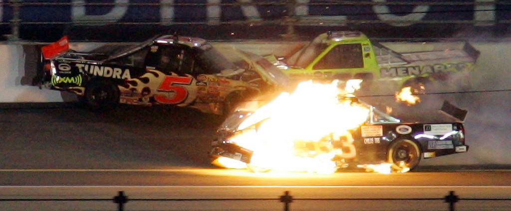 . P.J. Jones\' truck (63) bursts into flames as he crashes along with Mike Skinner (5) and Matt Crafton (88) during the NASCAR Craftsman Trucks Series race Friday night, Feb. 15, 2008, at Daytona International Speedway in Daytona Beach, Fla. (AP Photo/Chris O\'Meara)