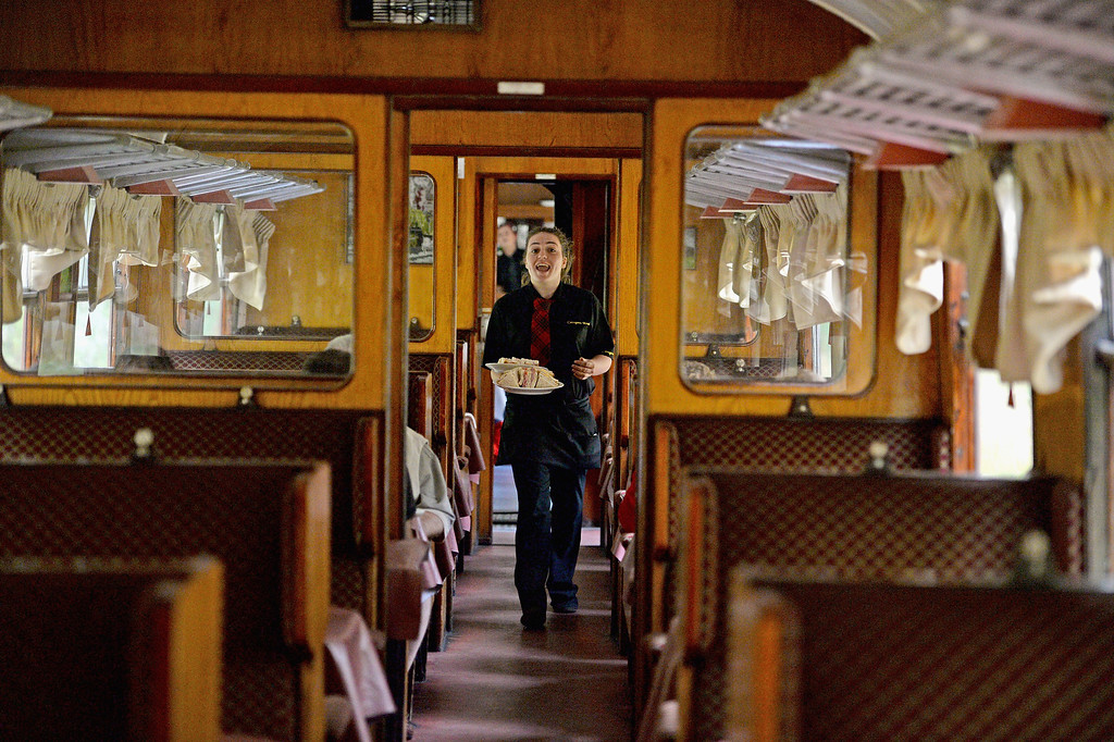 . Rebecca Cameron works in the buffet car on a 1952 British Rail Ivatt number 46512 at Strathspey Steam Railway on August 27, 2013 in Aviemore,Scotland.  (Photo by Jeff J Mitchell/Getty Images)