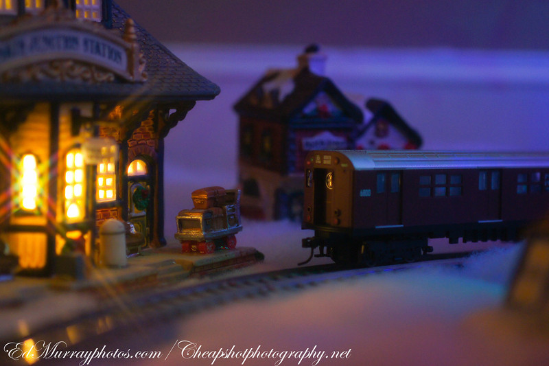 "Take the Number 6 Train to the Village:I set up a Christmas village and train underneath our tree. This is the 2nd train to run the ""tree loop"". The original train was destroyed by my 3 year old, who dezided to rampage through the village like Godzilla through Tokyo."