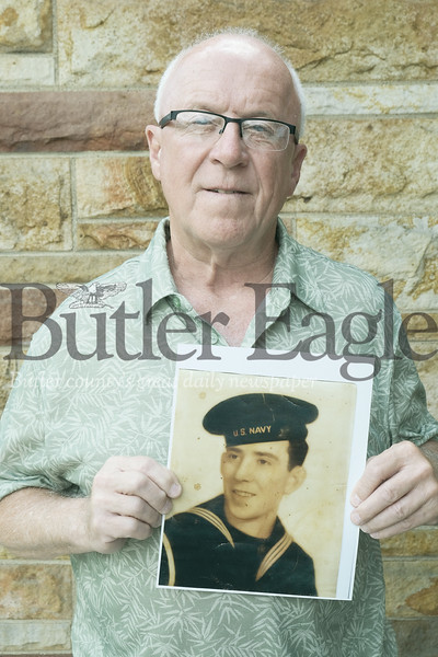 "Cornelius ""Neil"" B. Dorcy of Butler Township stands with a picture of his  namesake  Navy Coxswain Cornelius Dorcy, who died shortly after the Invasion of Normandy began at the age of 21.Photo by Lauryn Halahurich"