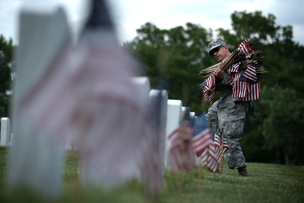 """. A member of the Fife and Drum Corps of the 3rd U.S. Infantry Regiment, \""""The Old Guard,\"""" participate in a \""""Flags-In\"""" ceremony May 23, 2013 at Arlington National Cemetery in Arlington, Virginia.  (Photo by Alex Wong/Getty Images)"""