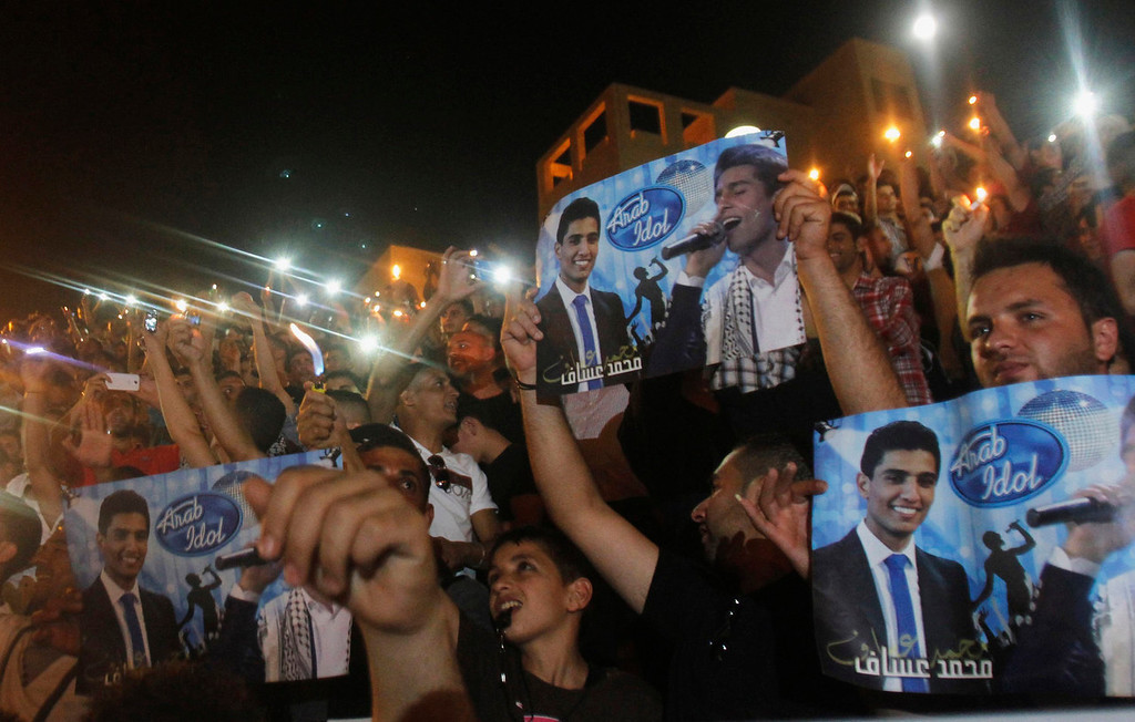 ". People celebrate Palestinian singer Mohammed Assaf\'s winning of ""Arab Idol\"" in the West Bank city of Nablus June 22, 2013. The 22-year-old Assaf, from the Gaza Strip, was named the winner of \""Arab Idol\"" in a TV talent contest in Beirut. REUTERS/Abed Omar Qusini"