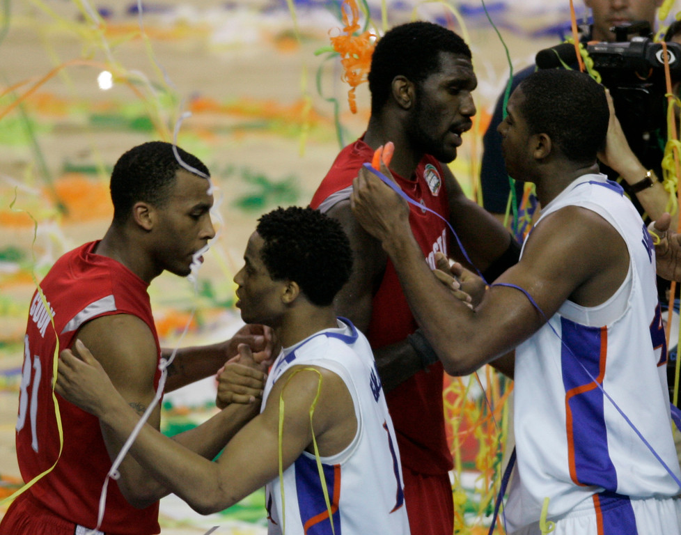 . Ohio State guard Daequan Cook, left and teammate Greg Oden congratulate Florida\'s Taurean Green, second left and Al Horford following Florida\'s 84-75 victory in the Final Four basketball championship game at the Georgia Dome in Atlanta, Monday, April 2, 2007. (AP Photo/Morry Gash)