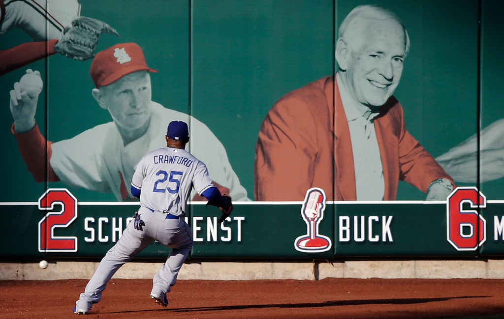 . Los Angeles Dodgers\' Carl Crawford chases a double hit by St. Louis Cardinals\' David Freese during the fifth inning of Game 2 of the National League baseball championship series Saturday, Oct. 12, 2013, in St. Louis. (AP Photo/Charlie Neibergall)