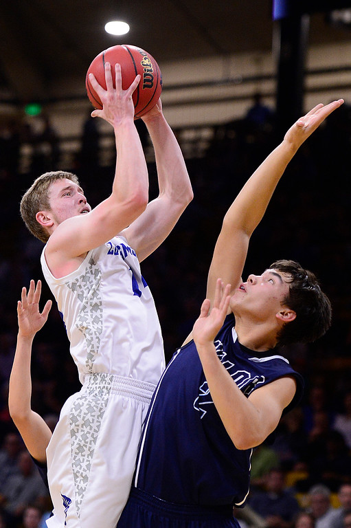 . Kolton Bachman (14) of Longmont shoots over the defense of Kayle Knuckles (2) of Valor Christian during the third quarter at the Coors Events Center on March 11, 2016 in Boulder, Colorado. Valor Christian defeated Longmont 58-53 to advance to the 4A finals of Colorado state basketball tournament.  (Photo by Brent Lewis/The Denver Post)