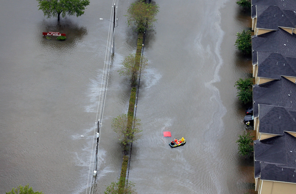 . A boat navigates through floodwaters from Tropical Storm Harvey on Tuesday, Aug. 29, 2017, in Houston. With its flood defenses strained, the crippled city of Houston anxiously watched dams and levees Tuesday to see if they would hold until the rain stops, and meteorologists offered the first reason for hope � a forecast with less than an inch of rain and even a chance for sunshine. (AP Photo/David J. Phillip)