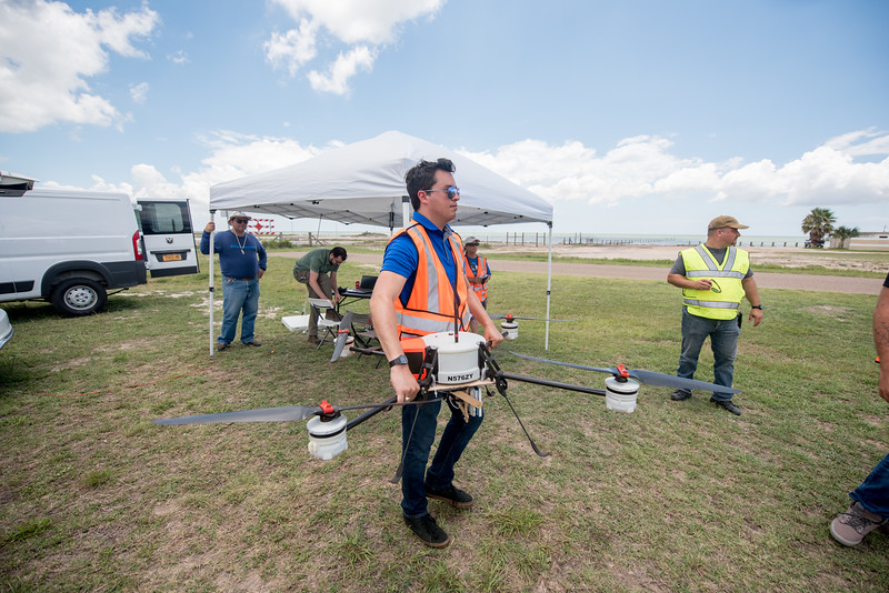 Daniel Mendez moves the AirRobot as they replace the battery prior to take off during the UTM demo.